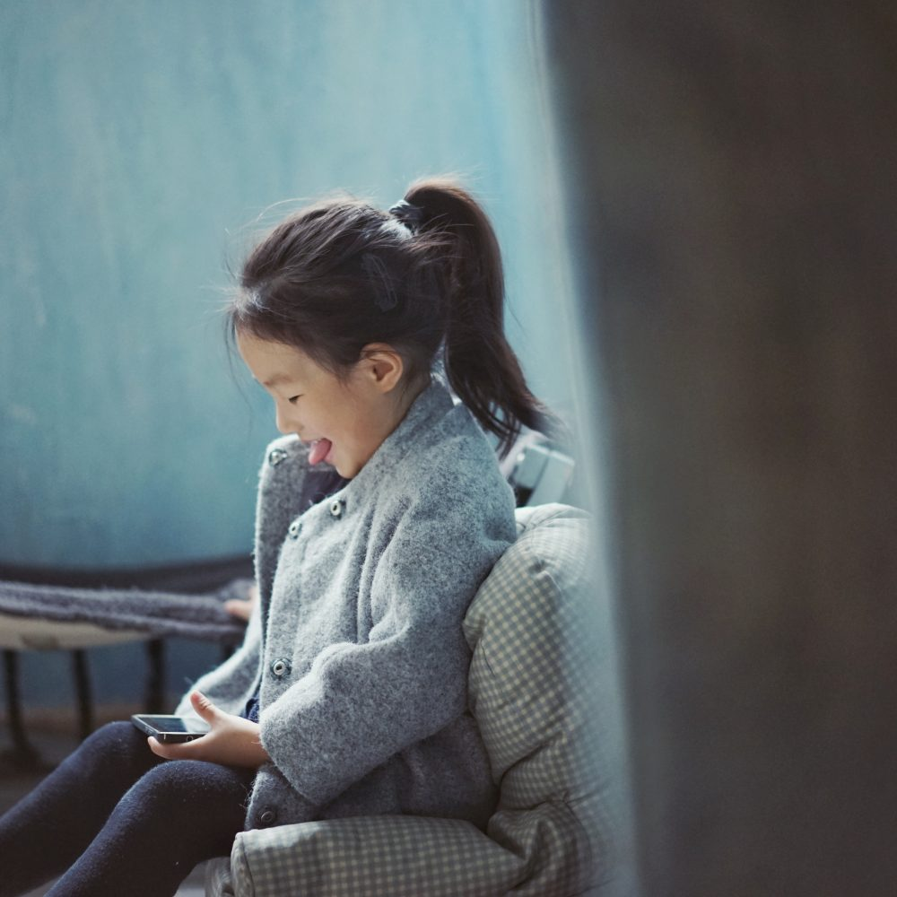 girl playing on iphone