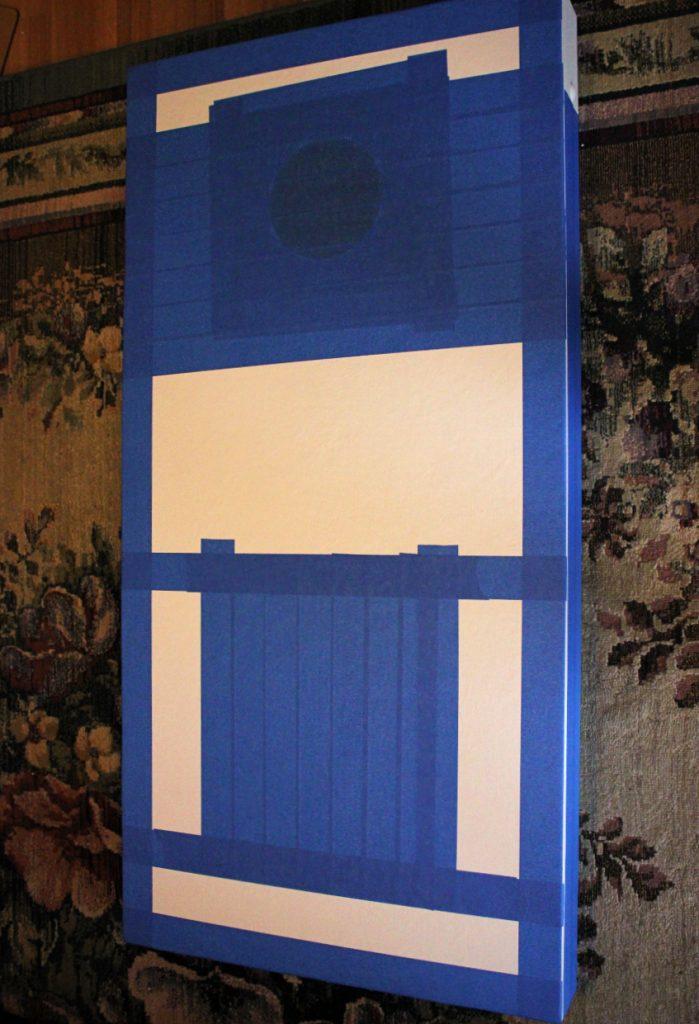 taped cornhole board